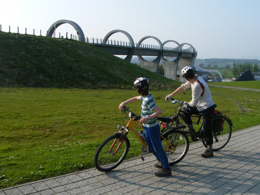 Callum and Chris cycling past the Falkirk Wheel